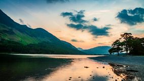 Stunning dusk over the lake and mountains in the Lake District in the UK, timelapse stock video