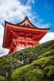 The Stunning entry building to the iconic Kiyomizu-dera buddhist temple, Kyoto, Japan. Low angle view of the Stunning bright orange entry building to the iconic royalty free stock images
