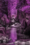 Stunning ethereal landscape of deep sided gorge with rock walls Stock Photos