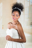 Stunning exotic bride wearing white dress Stock Photos