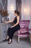 Stunning fashionable model sitting in a chair elegant businesswoman Royalty Free Stock Photography