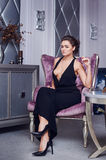 Stunning fashionable model sitting in a chair elegant businesswoman Stock Images