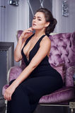Stunning fashionable model sitting in a chair elegant businesswoman Royalty Free Stock Photo
