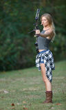 Stunning female archer in action Royalty Free Stock Images