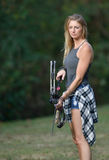 Stunning female archer in action Royalty Free Stock Photo