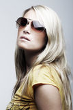 Stunning female model wearing sunglasses royalty free stock photography