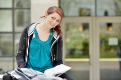 Stunning female student studies outside Royalty Free Stock Photography