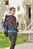 Stunning female student walking to class Royalty Free Stock Photo