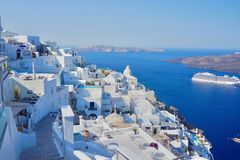 Stunning from Fira, Santorini island in Greece. Fira, Santorini island, Greece. Clear blue sky with beautiful composition of white buildings and aegean sea as royalty free stock images