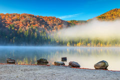 Stunning foggy autumn landscape,Saint Anna Lake,Transylvania,Romania Royalty Free Stock Images