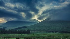 Stunning foggy dawn over the mountains of Glencoe in Scotland stock footage