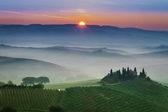 Stunning foggy green fields at sunset in Tuscany. Europe stock images
