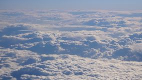 Stunning footage of aerial view above clouds from airplane stock video footage
