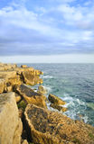 Stunning geological rock cliff formations at sea Stock Photos