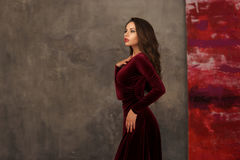 Stunning girl in cherry red dress Stock Images