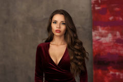 Stunning girl in cherry red dress Royalty Free Stock Image