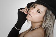 Stunning Girl Holding her Hat stock photo