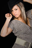 Stunning Girl Holding her Hat. Shot of a Stunning Girl Holding her Hat royalty free stock image