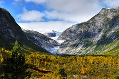 Amazing Glacial Valley Autumn Scenery, Background. Stunning glacial valley and mountains, autumn scenery background. Arctic wilderness royalty free stock images