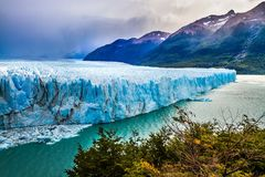 Stunning glacier Perito Moreno. In the Patagonia. The concept of active and extreme tourism. Argentine province of Santa Cruz. The cloudy sky covers the horizon royalty free stock photo
