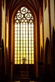 Stunning gorgeous sunset light through an old medieval Gothic church window in Europe. Stunning gorgeous sunset light through an old medieval Gothic church Royalty Free Stock Photos