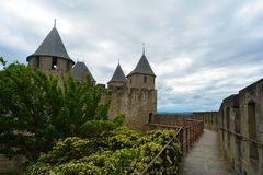 The stunning gothic castle of Carcassonne, surrounded by beautiful nature.France royalty free stock photography