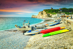 Stunning gravel beach and colorful boats, Etretat, Normandy, France Stock Photo