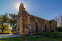 Stunning Halo of Back-lit Bell Tower of the Historic Old West Spanish Mission Espada Stock Photography