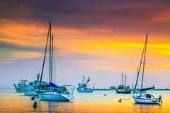 Stunning harbor with sailing boats and fishing boats at sunset royalty free stock image