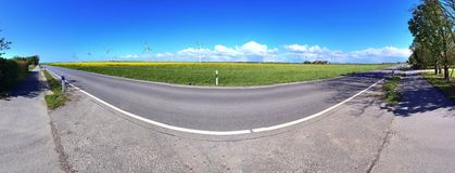 Stunning high resolution panorama of a northern german agricultural landscape on a sunny day with white cloud formations on a blue. Sky stock image