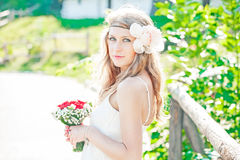 Stunning hippie bride with flowers outdoors Stock Photo