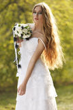 Stunning hippie bride with flowers Stock Photos