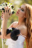 Stunning hippie bride with flowers Royalty Free Stock Photography