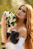Stunning hippie bride with flowers Royalty Free Stock Photo