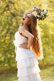 Stunning hippie bride with flowers Royalty Free Stock Image