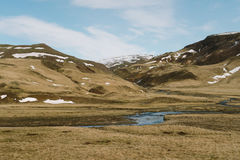 Stunning Iceland landscape photography. Beautiful river on the country side in the mountains of Iceland Royalty Free Stock Images