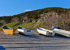 Stunning image of boats pulled ashore on wharf in summer Stock Images