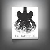 A stunning image of a guitar and tree Stock Photography