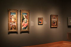 Stunning image of historic masterpieces displayed on walls, Cleveland Art Museum, Ohio, 2016. Large, airy room with gorgeous masterpieces of art and sculpture Stock Images