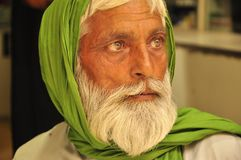 Stunning image of a Pakistani man. Stunning portrait Pakistani man with emerald green veil Royalty Free Stock Images