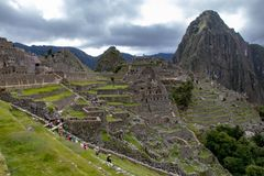 The Inca Ruins at Machu Picchu. The stunning Inca ruins at Machu Picchu, Peru with an assortment of intact stone buildings built on multiple terraces stock photos