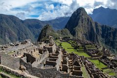 The Inca Ruins at Machu Picchu. The stunning Inca ruins at Machu Picchu, Peru with an assortment of intact stone buildings built on multiple terraces royalty free stock images