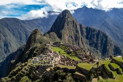 The Inca Ruins at Machu Picchu. The stunning Inca ruins at Machu Picchu, Peru with an assortment of intact stone buildings built on multiple terraces royalty free stock image