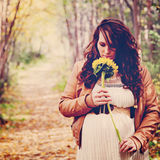 Stunning instagram of pregnant woman on forest path Royalty Free Stock Photo