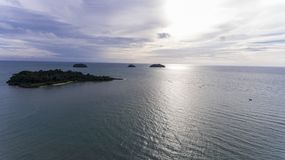 Stunning islands off the coast of Koh Chang, Thailand. Stunning islands covered in greenery and surrounded by amazing blue water off the coast of Koh Chang royalty free stock photo