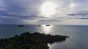 Stunning islands off the coast of Koh Chang, Thailand. Stunning islands covered in greenery and surrounded by amazing blue water off the coast of Koh Chang stock images