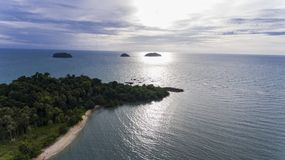 Stunning islands off the coast of Koh Chang, Thailand. Stunning islands covered in greenery and surrounded by amazing blue water off the coast of Koh Chang stock photo
