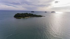 Stunning islands off the coast of Koh Chang, Thailand. Stunning islands covered in greenery and surrounded by amazing blue water off the coast of Koh Chang royalty free stock photos