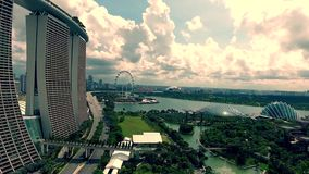 Stunning 4k aerial drone view of modern urban sunny architecture nature cityscape of towers on river of Singapore Asia stock video