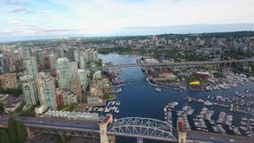 Stunning 4k aerial drone view on Vancouver modern architecture skyscraper by river downtown cityscape seascape skyline. Amazing aerial drone view on tourist boat stock video footage